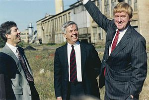 "Bill Weld - Governor Weld announcing the revival of ""The Shoe"" as Cummings Center with Cummings Properties president James McKeown and founder Bill Cummings."