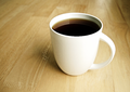 Black Coffee and Tea in White Cup is Hot.png