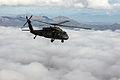 Black Hawk soars over clouds 150303-Z-LW032-001.jpg