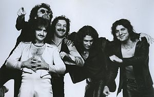 "1977 publicity photo of Blue Öyster Cult with the 1971-81 lineup, L-R: Donald ""Buck Dharma"" Roeser (bottom); Eric Bloom; Albert Bouchard; Allen Lanier; Joe Bouchard"