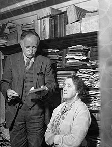 Bob Owen, Croesor, with his wife and some of his books (8469901287).jpg