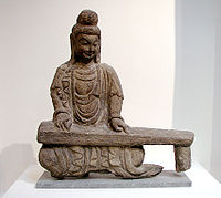 Rock carving of a bodhisattva playing a guqin, found in Shanxi, Northern Wei Dynasty (386–534).