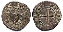 An old coin depicting a head on one side and a cross on the other side
