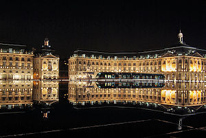 Place de la Bourse - Place de la Bourse at night with the Miroir d'eau and tram