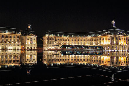 Place de la Bourse in Bordeaux, an example of French baroque architecture. Bordeaux place de la bourse with tram.JPG