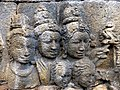 Borobudur - Divyavadana - 081 N, King Sikhandi orders his people to throw dust on Ven Mahakatyayana (detail 2) (11706262304).jpg