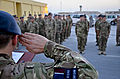 British air force Group Capt. Domonic Stamp, foreground, assigned to the 379th Air Expeditionary Wing, salutes his troops during the Battle of Britain Day ceremony at an undisclosed base in Southwest Asia, Sept 130920-F-JF989-043.jpg