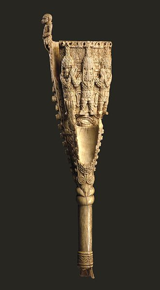 Benin art - This ivory double bell (Egogo) is one of the oldest surviving African ivory sculptures; only six of these ivory gongs are known. They were used by the oba during the Emobo ceremony to drive away evil spirits. Carved with the oba, supported by his military commander and his heir.