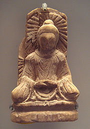 A Buddha statue from Tumshuq, Xinjiang. 5th century. This is an example of Serindian art.