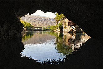 Subterranean river - The cave of source of the Buna can be entered by boat and dived through a cave system serving as an effluence of the Zalomka.