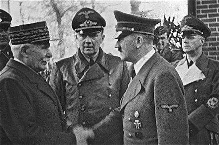 Petain meeting Hitler at Montoire on 24 October 1940; Joachim von Ribbentrop on the right, Hitler's interpreter, Paul Schmidt in the centre. Bundesarchiv Bild 183-H25217, Henry Philippe Petain und Adolf Hitler.jpg
