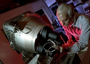 CGRO space observatory Dr. Gerald Fishman Working on the Burst and Transient Source Experiment (BATSE) 9127922.jpg