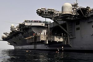 CVN-70-120323-N-OK922-313 ARABIAN SEA (March 23, 2012) Sailors jump off aircraft elevator No. 4 uring a swim call aboard the Nimitz-class aircraft carrier USS Carl Vinson (CVN 70).JPG