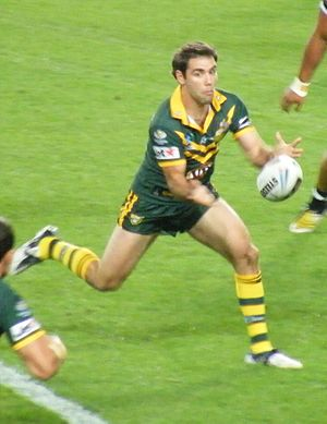 Rugby league gameplay - Cameron Smith passes during a rugby league match