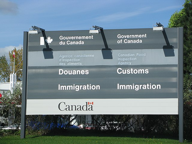 Canadian Customs and Immigration https://upload.wikimedia.org/wikipedia/commons/thumb/6/64/Canadian_Customs_and_Immigration_sign.jpg/640px-Canadian_Customs_and_Immigration_sign.jpg