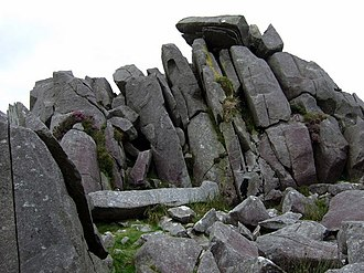 Bluestone - Carn Menyn bluestones.These dolerite slabs, split by frost action, seem to be stacked ready for the taking and many have been removed over the centuries for use locally but it remains unresolved whether the Stonehenge bluestones were conveyed thence by human or glacial means.