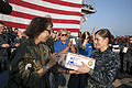 Carolyn Blashek, left, the founder of Operation Gratitude, gives U.S. Navy Hospital Corpsman 2nd Class Brook Oekerman the organization's 1 millionth care package aboard the guided missile cruiser USS 131212-N-PL185-262.jpg
