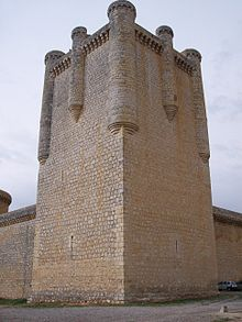 A stone tower at the corner of the defensive walls.