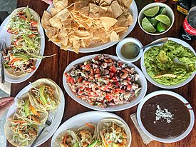 Ceviche, seafood tacos, chips, guacamole, beans (34662952704).jpg