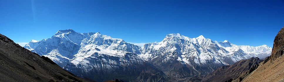 The Annapurna Himal from the northeast. Left to right: Annapurna II and IV (close together); a major col; Annapurna III and Gangapurna; Annapurna I.