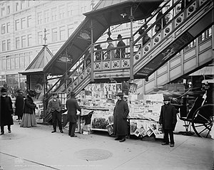 23rd Street (IRT Sixth Avenue Line) - A newsstand beneath one of the entrances to 23rd Street Station in December 1902.