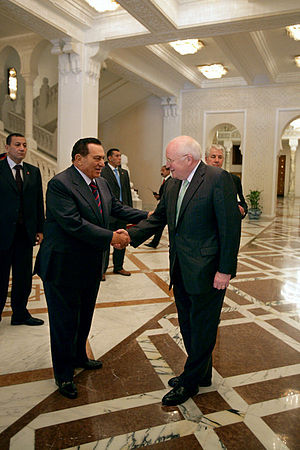 Vice President Dick Cheney shakes hands with E...