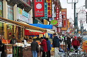 Urban culture - Toronto's Chinatown. The everyday use of, and availability of services in, many languages is promoted by municipal government.