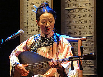 Nanguan music - Wang Xin-xin playing Nanguan pipa. The Nanguan pipa is held in the ancient manner like a guitar which is different from the near-vertical way pipa is now usually held.