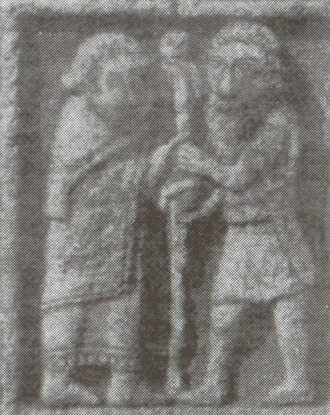 "Diarmait mac Cerbaill - Scene from the east face of the Cross of the Scriptures, Clonmacnoise. The figures probably represent Saint Ciarán and Diarmait mac Cerbaill founding Clonmacnoise: ""Then Ciarán planted the first stake, and Diarmait son of Cerball was along with him. Said Ciarán to Diarmait when setting the stake, 'Let, O warrior, thy hand be over my hand, and thou shalt be in sovranty over the men of Ireland.'"""