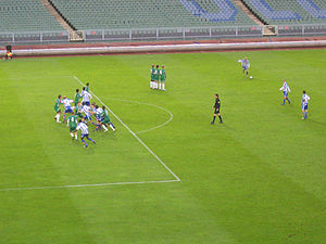 A direct free kick taken by IFK G�teborg (in blue and white).