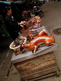 Dog meat for sale in a market in Hanoi, Vietnam (6827793370).jpg