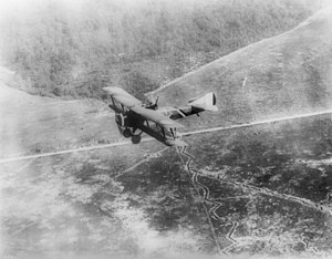 """Downward view of a """"Chateau Thierre Aeroplane"""", a World War I aircraft, in flight over Argone Forest and French trenches, ca.1914-1918 (CHS-5031).jpg"""