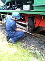 Driver checking the oil in the ABT Locomotive (3938674255).jpg