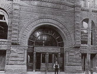 E. J. Lennox - Lennox standing in front of one of his buildings, the Freehold Loan Building, at Adelaide and Victoria Streets