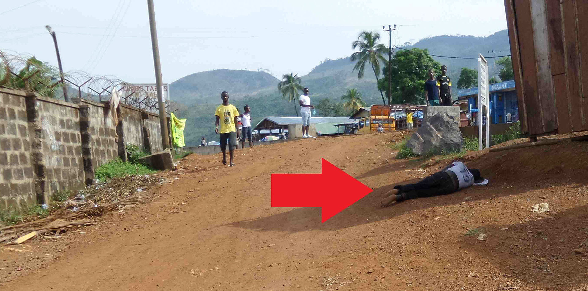 Ebola infected person lying in Lakka Sierra Leone.jpg