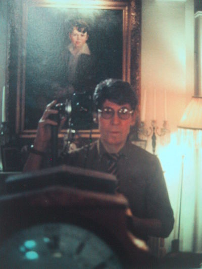 Photographic self-portrait by Edgar de Evia reflected with the oil portrait by M. Jean McLane of himself as a child (circa 1990). Edgar de Evia self-portrait.jpg