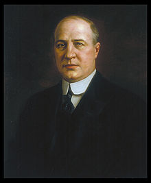 A color portrait of a balding man in his late forties