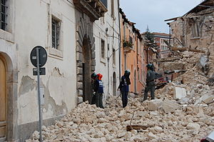 2009 L'Aquila earthquake - Emergency personnel review damaged buildings