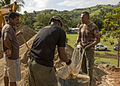 Engineers from US Air Force, Japan Ground Self Defense Force and Fiji military build a classroom during Pacific Partnership 2015 150613-M-DN141-146.jpg
