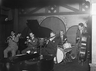 Bobby Hackett - Ernie Caceres, Bobby Hackett, Freddie Ohms, and George Wettling, Nick's, New York City, 1940s  Photography by William P. Gottlieb