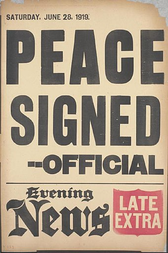 A British news placard announces the signing of the peace treaty. Evening News placard Versailles Treaty signed June 28 1919.jpg