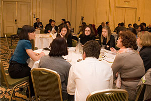 meeting with participants at round tables