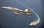 F-A-18F Super Hornet flies over the USS Gerald R. Ford.jpg