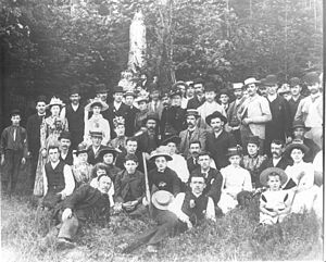 Truman Smith Baxter - Future Mayor T.S. Baxter reclining in center at the First Presbyterian Church picnic in North Vancouver July 1891. His future wife Sarah Whiteside is the second woman standing from the left.
