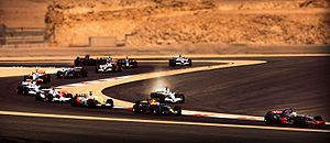 The First lap of the 2008 Bahrain Grand Prix with Jenson Button leaving the track