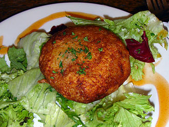 Fishcake - A fishcake served on salad