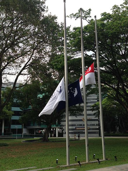 Flags at half-staff at Singapore Management University following the death of Lee Kuan Yew Flags at half staff to mark the death of Lee Kuan Yew, College Green, Singapore Management University - 20150323-01.jpg