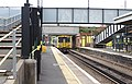 Footbridge and 507011 at Rock Ferry station.jpg
