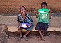 Friends at Chikondi Malawi eating nsima, ndiwo and masamba.jpg