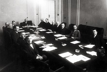 The cabinet of Prime Minister Leopold Skulski in session in 1920. Due to the deep political divides of the early Second Republic, governments were short-lived, frequently falling within months. Gabinet Skulskiego.jpg